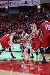 11 February 2017:  Keyshawn Evans(3) splits between defenders Jayden Hodgson and Nate Kennell to get to the lane during a College MVC (Missouri Valley conference) mens basketball game between the Bradley Braves and Illinois State Redbirds in  Redbird Arena, Normal IL