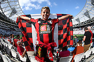 a young Bournemouth fan inside London Stadium before k/o. Premier league match, West Ham Utd v AFC Bournemouth at the London Stadium, Queen Elizabeth Olympic Park in London on Sunday 21st August 2016.<br /> pic by John Patrick Fletcher, Andrew Orchard sports photography.