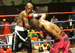 David Rajwili of South Africa bunch Michael Nyawade (L) of Kenya during their Mac Series Professional Boxing Bonaza at Safaricom Indoor Arena in Nairobi on November 5, 2016. Rajwili won. Photo/Fredrick Onyango/www.pic-centre.com (KEN)