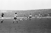 Dublin falls to the ground as Kerry swoops in to grab the ball during the All Ireland Senior Gaelic Football Semi Final, Dublin v Kerry in Croke Park on the 23rd of January 1977. Dublin 3-12 Kerry 1-13.