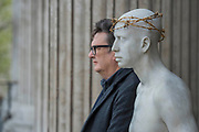 "Mark Wallinger with his work - Kate Allen, Director of Amnesty International UK, helped by Canon Mark Oakley (Chancellor of St Paul's Cathedral), installs Mark Wallinger's 'Ecce Homo' statue at St Paul's Cathedral. The life-size sculpture shows the figure of Jesus Christ and was the first artwork to be shown on Trafalgar Square's fourth plinth in 1999.Mark Wallinger, who won the Turner Prize in 2007, said: ""This vulnerable figure will stand at the top of the steps outside the entrance to St Paul's Cathedral as we approach Easter to highlight the plight of people around the world who are imprisoned and whose lives are threatened for speaking the truth, and for what they believe."""