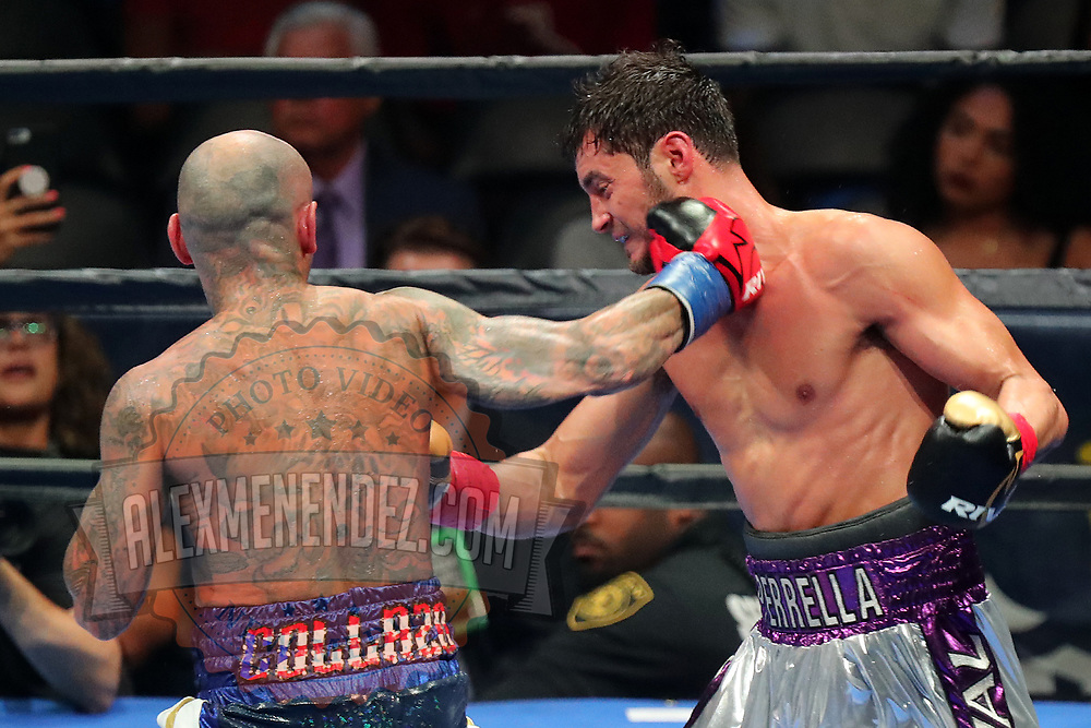Luis Collazo throws a righthand to the neck of Bryant Perrella during a Premier Boxing Champions fight on Saturday, August 4, 2018 at the Nassau Veterans Memorial Coliseum in Uniondale, New York.  (Alex Menendez via AP)
