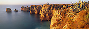 PORTUGAL, ALGARVE, SOUTH COAST Ponta da Piedade, rocky peninsula with a lighthouse, jutting into the sea just south of Lagos
