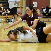 Photo: Jeffery Jones<br /> <br /> Rehoboth Lady Lynx Jessica Triplett (13) and Adriana Pete (7) both dive for the ball Tuesday night as they hosted the Thoreau Lady Hawks at Rehobth High School.