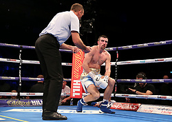 Jake Ball (right) on the floor as the referee counts down during the vacant WBA continental light-heavyweight championship contest at The O2 Arena, London.