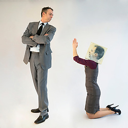 Businesswoman with mask pleading to businessman