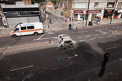 © Licensed to London News Pictures . 07/08/2011 . London , UK . A burned out car on Tottenham High Street . Overnight rioting and looting in Tottenham , following a protest against the police shooting of Mark Duggan . Photo credit : Joel Goodman/LNP