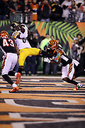 Pittsburgh Steelers wide receiver Antonio Brown (84) leaps and catches a 6 yard touchdown pass that ties the fourth quarter score at 20-20 while covered by Cincinnati Bengals free safety George Iloka (43) and Bengals cornerback Dre Kirkpatrick (27) during the 2017 NFL week 13 regular season football game against the Cincinnati Bengals, Monday, Dec. 4, 2017 in Cincinnati. The Steelers won the game 23-20. (©Paul Anthony Spinelli)