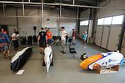 De fietsen staan klaar voor de technische keuring. Het Human Power Team Delft en Amsterdam (HPT), dat bestaat uit studenten van de TU Delft en de VU Amsterdam, is in Duitsland voor een poging het uurrecord te verbreken op de Dekrabaan met de VeloX4. In september wil het HPT daarna een poging doen het wereldrecord snelfietsen te verbreken, dat nu op 133 km/h staat tijdens de World Human Powered Speed Challenge.<br /> <br /> The Human Power Team Delft and Amsterdam, consisting of students of the TU Delft and the VU Amsterdam, is in Germany for the attempt to set a new hour record on a bicycle with the special recumbent bike VeloX4. They also wants to set a new world record cycling in September at the World Human Powered Speed Challenge. The current speed record is 133 km/h.