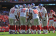 KANSAS CITY, MO - SEPTEMBER 29:  Quarterback Eli Manning #10 of the New York Giants huddles with the offense against the Kansas City Chiefs during the first half on September 29, 2013 at Arrowhead Stadium in Kansas City, Missouri.  (Photo by Peter G. Aiken/Getty Images) *** Local Caption *** Eli Manning