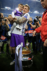 3rd June 2017 - UEFA Champions League Final - Juventus v Real Madrid - Toni Kroos of Real poses with his son and the trophy - Photo: Simon Stacpoole / Offside.