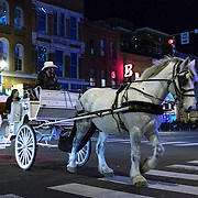A horse drawn carriage strolls the street on Music Row in downtown Nashville, Tennessee on Friday, November 13, 2015. (Alex Menendez via AP)