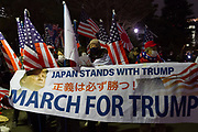 "Several hundred people, waving flags and banners, take part in a ""March For Trump"" rally  in support of the out-going United States President, Donald Trump. Tokyo, Japan. Wednesday January 6th 2021. The rally of mostly Japanese people took place as part of a similar rally by Trump-supporters in Washington DC as the results of the 2020 US Presidential election were confirmed."