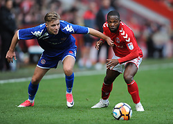 Charlton Athletic's Mark Marshall and Truro City's Connor Riley-Lowe (left) battle for the ball