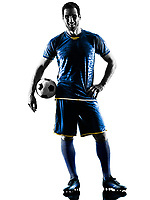 one caucasian soccer player man standing smiling in silhouette isolated on white background