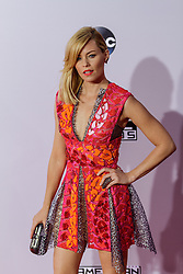 LOS ANGELES, CA - NOV 23 Actress Elizabeth Banks attends the 42nd Annual American Music Awards wearing a dress by Peter Pilotto, Nicholas Kirkwood shoes, Reece Hudson clutch, a Casa Reale ring and Melissa Kaye Jewelry earrings with hair braids by Adir at the Nokia Theatre L.A. in Los Angeles, California USA. 2014 Nov 23. Byline, credit, TV usage, web usage or linkback must read SILVEXPHOTO.COM. Failure to byline correctly will incur double the agreed fee. Tel: +1 714 504 6870.