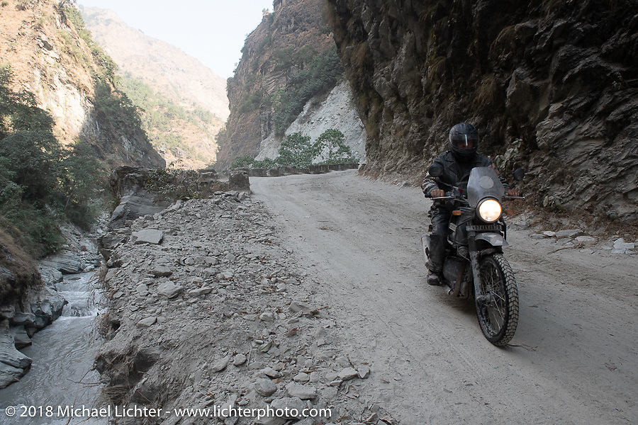 Kelly Modlin riding through a narrow canyon on Day-7 of our Himalayan Heroes adventure riding from Tatopani to Pokhara, Nepal. Monday, November 12, 2018. Photography ©2018 Michael Lichter.