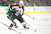 DALLAS, TX - SEPTEMBER 26:  John Mitchell #7 of the Colorado Avalanche controls the puck against the Dallas Stars in an NHL preseason game on September 26, 2013 at the American Airlines Center in Dallas, Texas.  (Photo by Cooper Neill/Getty Images) *** Local Caption *** John Mitchell