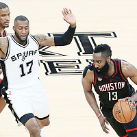 01 May 2017: Houston Rockets guard James Harden (13) drives past San Antonio Spurs guard Jonathon Simmons (17) on a screen set by Houston Rockets forward Trevor Ariza (1) during the Houston Rockets 126-99 victory over the San Antonio Spurs, in game 1 of the Western Conference Semi Finals, at the AT&T Center, San Antonio, Texas, USA.