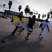 Visitors to the Venice Beach boardwalk take in the sights.