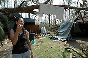 Pamela DeBaun surveys the damages to her home after Hurricane Katrina. Ten years ago I was on the first helicopter headed to the gulf coast after Hurricane Katrina made landfall. I rode with Governor Barbour as he surveyed the Gulf Coast in an open door Huey for the first time, seeing first hand the devastation from this historic storm. I stayed with Mississippi Emergency Management documenting the first two weeks of the States response to Hurricane Katrina and the devastation is left in its wake. I continued to photograph Hurricanes Katrina over the next three years. Photo ©Suzi Altman