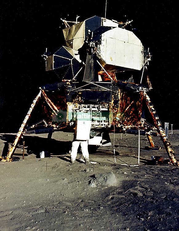 """The Moon - (FILE) -- Man's first landing on the Moon was accomplished at 4:17 p.m. on Sunday, July 20, 1969 as Lunar module """"Eagle"""" touched down gently on the Sea of Tranquility on the east side of the Moon. Astronaut Edwin E. Aldrin Jr., Lunar Module Pilot, removes scientific experiment packages from a stowage area in the Lunar Module's descent stage. Left behind on the lunar surface by Aldrin and Neil A. Armstrong, Apollo 11 Commander, were a Passive Seismic Experiments Package and a Laser Ranging Retro Reflector. Photo by CNP/ABACAPRESS.COM"""