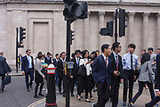 Foreign business students make their way across Threadneedle Street, beneath the tall pillars and columns of the Bank of England, on 4th July, in London, United Kingdom. (Photo by Richard Baker / In Pictures via Getty Images)