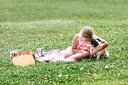 """Elli Rose Focht and her pug Peppermint, during a picnic at Shelby Farms ,  one of the largest urban parks in the country, in Memphis, Tennessee. MSN Living's website named Memphis among the Top 20 travel destinations in the world, making it the second Top 20 ranking for Memphis this year. In December, National Geographic Traveler named the city one of the 20 """"must-see places"""" in the world."""