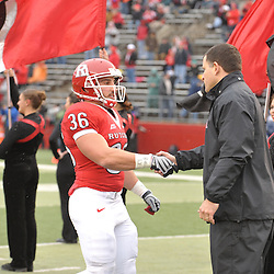 Dec 5, 2009; Piscataway, NJ, USA; Rutgers cornerback Abdul Smith (36) shakes hands with head coach Greg Schiano during the senior ceremony before first half NCAA Big East college football action between Rutgers and West Virginia at Rutgers Stadium.