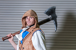© Licensed to London News Pictures. 14/03/2015. Newham, London, UK.  A man dressed as Axe Man from Assassins Creed Unity, one of many cosplayers attending the London Comic Con at the Excel Centre in Docklands. Photo credit : Stephen Chung/LNP