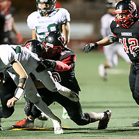 (Photograph by Bill Gerth for SVCN) Homestead #11Jack Barden is tackled by Westmont #90 Silver Ponce and #44 Daniel (DJ) Monroe in a CCS Division 4 Semifinal Football Game at Westmont High School, Campbell CA on 11/18/16.  (Westmont 48 Homestead 27)