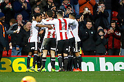 Brentford players celebrate a goal from Brentford midfielder Jota (23) (score 4-2) during the EFL Sky Bet Championship match between Brentford and Rotherham United at Griffin Park, London, England on 25 February 2017. Photo by Andy Walter.
