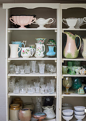 Dresser of vases at Green and Gorgeous.