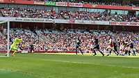 Football - 2017 / 2018 Premier League - Arsenal vs. West Ham United<br /> <br /> Joe Hart (West Ham United) parries a GranitXhaka (Arsenal FC) free kick as the line breaks to defend at The Emirates.<br /> <br /> COLORSPORT/DANIEL BEARHAM