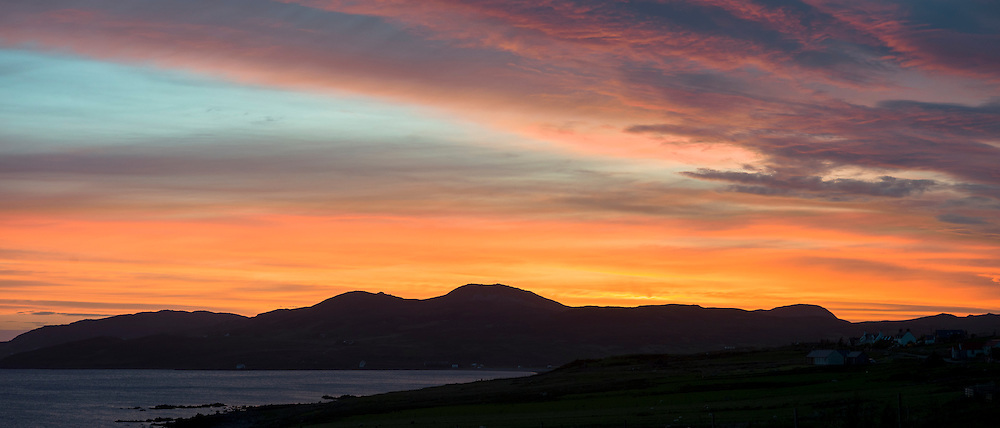 Colourful red sunset over the Summer Isles, part of the Inner Hebrides, from Achiltibuie on the Coigach west coast of Scotland