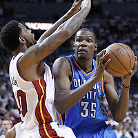 21 June 2012: Oklahoma City Thunder small forward Kevin Durant (35) goes to the basket against Miami Heat power forward Udonis Haslem (40) during the Miami Heat 121-106 victory over the Oklahoma City Thunder, in Game 5 of the 2012 NBA Finals, at the AmericanAirlinesArena, Miami, Florida, USA. The Miami Heat wins the series 4-1.