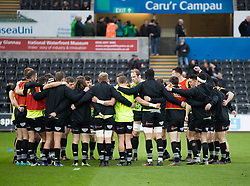 Ospreys team huddle during the pre match warm up<br /> <br /> Photographer Simon King/Replay Images<br /> <br /> Guinness PRO14 Round 19 - Ospreys v Connacht - Friday 6th April 2018 - Liberty Stadium - Swansea<br /> <br /> World Copyright © Replay Images . All rights reserved. info@replayimages.co.uk - http://replayimages.co.uk