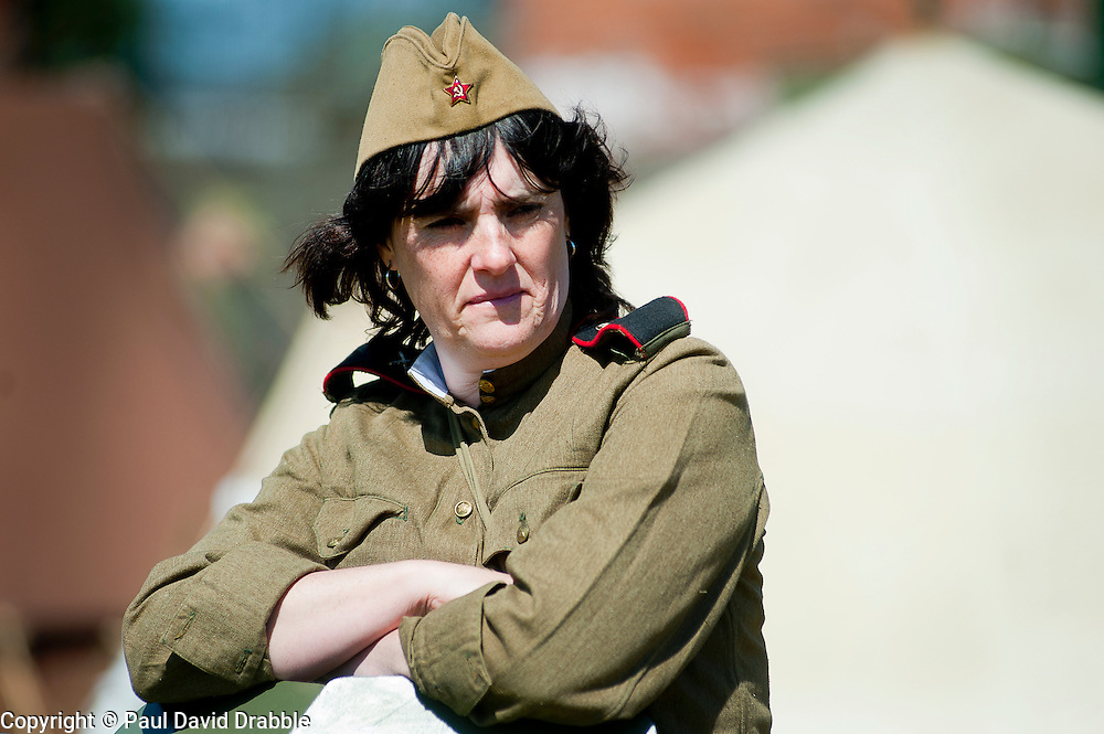 """A female Re-enactor portrays a  Soviet soldier from the Russian 13th Guards Rifle Division """"Poltavaskaya"""" during a world war Two living History event at Fort Paull Nr Hull May 2011 Image © Paul David Drabble"""