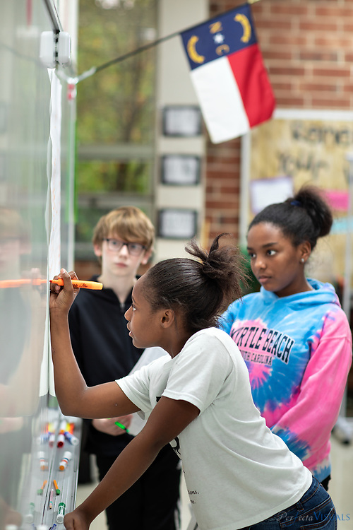 Seventh grade students engage in classroom activities at Northeast Middle School in McLeansville, N.C. on Wednesday, October 16, 2019. <br /> <br /> Photographed, Wednesday, October 16, 2019, in Greensboro, N.C. JERRY WOLFORD and SCOTT MUTHERSBAUGH / Perfecta Visuals