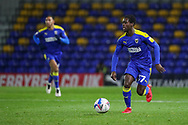 AFC Wimbledon defender Paul Osew (37) dribbling during the EFL Trophy match between AFC Wimbledon and U21 Arsenal at Plough Lane, London, United Kingdom on 8 December 2020.