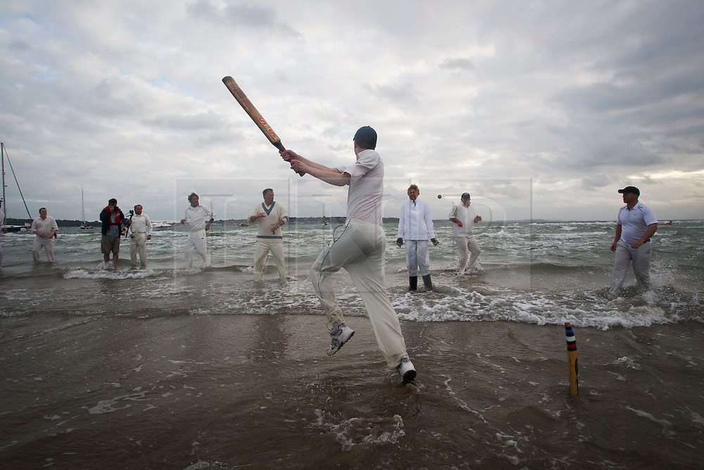 © London News Pictures. 17/09/2012. Southampton, UK.  Teams play a cricket match on the Bramble Bank in the middle of The Solent on September 17, 2012.  The annual cricket match between the Royal Southern Yacht Club and The Island Sailing Club, takes place on a sandbank which appears for 30 minutes at lowest tide. The game lasts until the tide returns. Photo credit : Ben Cawthra/LNP.