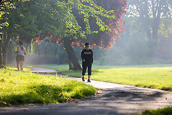 © Licensed to London News Pictures. 07/09/2021. London, UK. A walker enjoys a warm misty morning in Chestnuts Park, north London as the mini heatwave continues in London. According to the Met office, temperatures over 28 degree Celsius are forecast today in London and the South East of England. Photo credit: Dinendra Haria/LNP