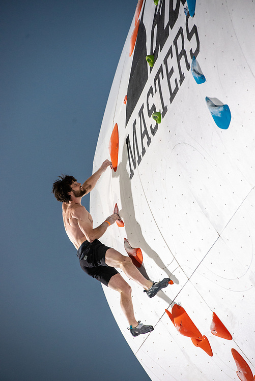 Jimmy Webb completing the route after defeating Joey Catama in an early matchup in the Finals round of the 2018 Psicobloc Masters competition.