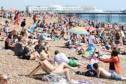 © Licensed to London News Pictures. 08/08/2015. Brighton, UK. Thousands of people are relaxing and sunbathing on Brighton Beach as the weather is very hot. Today August 8th 2015. Photo credit : Hugo Michiels/LNP