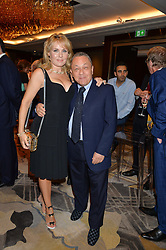 EMMA BENTON-HUGHES and DAVID SULLIVAN at a party to celebrate Jack Petchey's 90th birthday in association with the Stroke Association held at the Shangri-La Hotel, Level 34, The Shard, London on 13th July 2015.