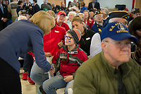 Jace Blad introduces himself to Senator Maggie Hassan during the Veterans Day ceremony at the NH Veterans Home on Friday morning.  (Karen Bobotas/for the Laconia Daily Sun)