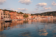 The picturesque harbour of Gaios at sunrise on Paxos, The Ionian Islands, The Greek Islands, Greece, Europe