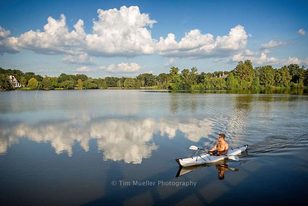 Mike Finsel paddles around City Park Lake. Finsel is paddling a folding kayak made by Oru Kayak.