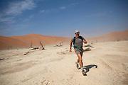 A man jogs in Deadvlei, Namibia.