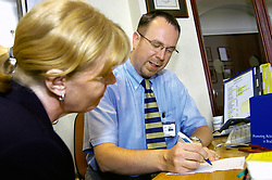 Male nurse practioner in consultation with patient in NHS health centre Yorkshire UK